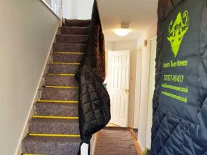 Moving Protection - Blankets protecting stairs and doors