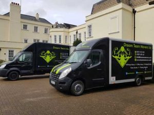 Removal trucks outside period mansion
